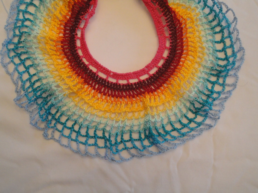 Crocheted rainbow skirt.