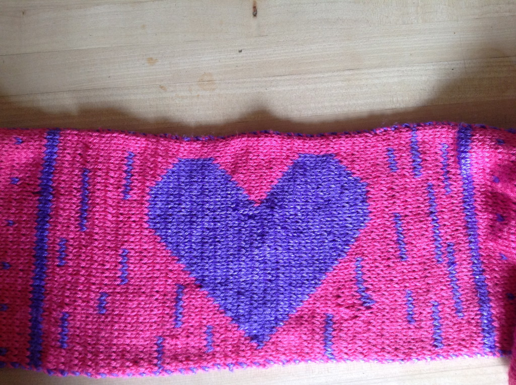 Heart knitted into scarf